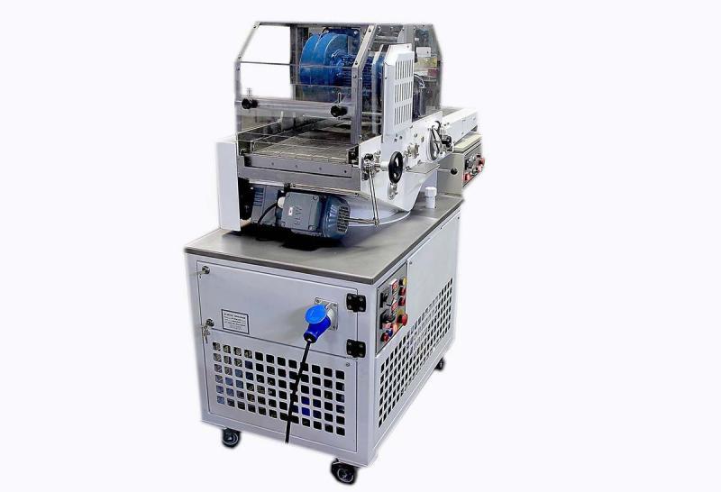 Máquina cobrideira de chocolate